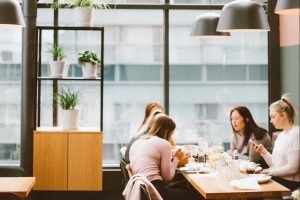 women enjoying drinks at a coffee shop